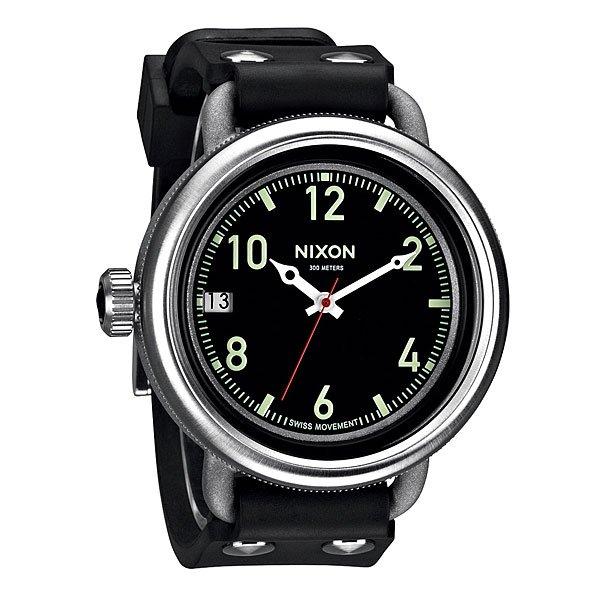 Часы Nixon October BlackНепревзойденный дизайн, подкрепленный отличными функциональными характеристиками. Уникальное куполообразное стекло, изобретательный дизайн корпуса и надежный замокМеханизмШвейцарский кварцевый механизмISA3 стрелки, возможность выставления датыТочность хода 1/20 секундыКорпус:Ширина 48, 5 ммВодонепроницаемость с характеристикой 300 м (выдерживает 30 атмосфер)Прочная многослойная конструкция изнержавеющей стали с пескоструйной отделкой,Закаленное куполообразное минеральное стекло с антибликовым покрытием на нижней стороне стеклаРемешок:Прочный ремешокиз специальной резиныс прочными стальными заклепкамиШирина: 25 ммНадежный запатентованный замок<br><br>Тип: Кварцевые часы<br>Возраст: Взрослый<br>Пол: Мужской
