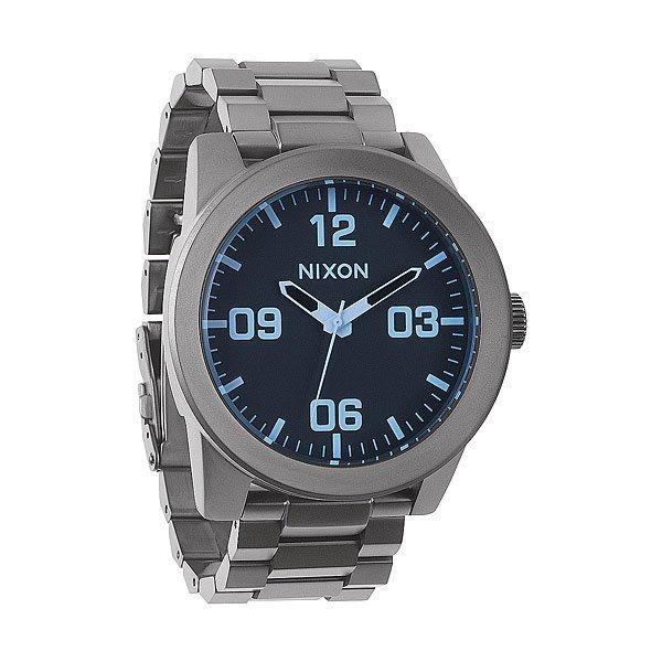 Часы Nixon Corporal Ss Gunmetal/Blue CrystalПусть Ваш ритм жизни будет полностью совпадать с ритмом окружающего Вас мира при помощи этих невероятно стильных часов от Nixon. Попробуйте и Вам это понравится.Корпус:Тип:&amp;nbsp;цельный корпус с привинчиваемой крышкой и заводной головкойДиаметр: 48 ммМатериал: нержавеющая стальБезель: фиксированный, скошеный для защиты стеклаЗакаленное минеральное стеклоВодонепроницаемость: 100 мМеханизм:&amp;nbsp;Кварцевый (Япония)Функции: часы, минуты, секундыТочность хода 1/20 секундыБраслет:&amp;nbsp;Массивные звенья из нержавеющей стали,&amp;nbsp;Замок с двойной застежкой<br><br>Тип: Кварцевые часы<br>Возраст: Взрослый<br>Пол: Мужской