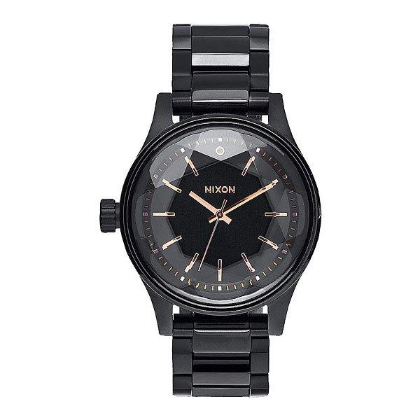 Часы женские Nixon Facet 38 All Black/Rose GoldСтильные часы с достаточно крупным корпусом классического дизайна, смягченные аккуратной огранкой минерального стекла, схожей с огранкой бриллианта. Nixon Facet созданы стать не просто аксессуаром, а настоящим сокровищем, готовым блистать подобно бриллианту.Характеристики:Японский кварцевый механизм Miyota. Задняя крышка с гравировкой из нержавеющей стали.Корпус: нержавеющая сталь, усиленное минеральное стекло с огранкой, напоминающей бриллиант. 3 стрелки.Материал браслета: нержавеющая сталь, замок из нержавеющей стали с двойной блокировкой и микрорегулировкой. Головка расположена с левой стороны.Двойное уплотнение головок.Водонепроницаемость 10 atm (100 м). Способ отображения времени: аналоговый (стрелки), формат 12 часов.<br><br>Цвет: черный<br>Тип: Кварцевые часы<br>Возраст: Взрослый<br>Пол: Женский