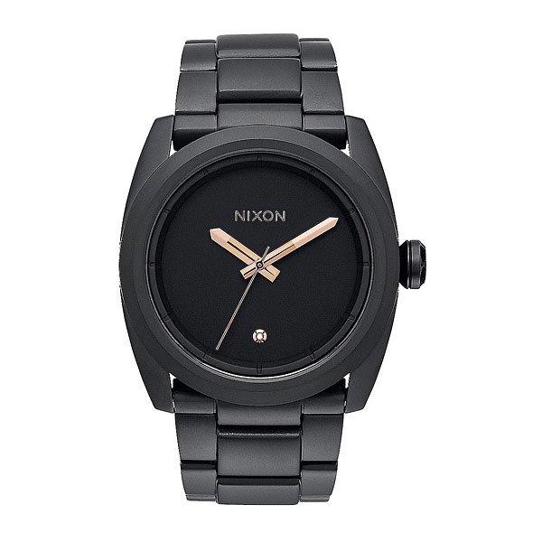 Часы Nixon Kingpin All Black/Rose GoldНовый часы от Nixon - первый номер среди других моделей часов. Стиль взят от их предшественника - модели The Player, но уKingpin имеется алмаз, находящийся на 6 часах, а также более молодежный и агрессивный вид.Характеристики:Японский кварцевый механизм Miyota. Задняя крышка из нержавеющей стали.Корпус: нержавеющая сталь, усиленное минеральное стекло. 3 стрелки.Материал браслета: нержавеющая сталь, замок из нержавеющей стали с двойной блокировкой и микрорегулировкой. Двойное уплотнение головок.Водонепроницаемость 10 atm (100 м). Способ отображения времени: аналоговый (стрелки), формат 12 часов.<br><br>Цвет: черный<br>Тип: Кварцевые часы<br>Возраст: Взрослый<br>Пол: Мужской