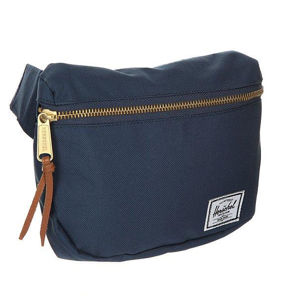 Сумка поясная Herschel Fifteen NavyКомпактная и удобная сумка, которую можно носить на талии или через плечо.Технические характеристики: Подкладка с полосатым принтом.Основное отделение на металлической молнии.Регулируемый ремень с пряжкой.Классическая нашивка с логотипом Herschel.<br><br>Цвет: синий<br>Тип: Сумка поясная<br>Возраст: Взрослый<br>Пол: Мужской