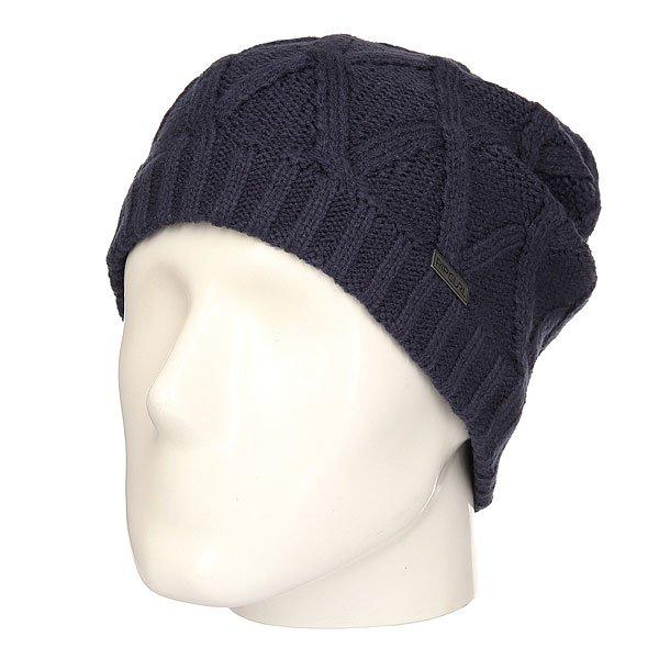Шапка Rip Curl Ledge Beanie NavyУютная и теплая шапка-«носок» для комфортных прогулок осенью и зимой.Характеристики:Металлический логотип. Крупная вязка.Эластичная манжета.<br><br>Цвет: синий<br>Тип: Шапка<br>Возраст: Взрослый<br>Пол: Мужской