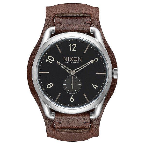 Кварцевые часы Nixon C45 Leather Black/Brown CuffСвежий взгляд на винтаж воплотился в Nixon C45. Эти часы со стальным корпусом и швейцарским кварцевым механизмом созданы для тех, кто желает быть впереди, а не следовать. И кто знает, возможно, именно Вы передадите эти часы следующему поколению, начав новую традицию, ведьNixon C45 действительно обладают дизайном вне времени и модных течений.Характеристики:Швейцарский кварцевый механизм.3 стрелки. Вспомогательный аналоговый циферблат. Прочный корпус из нержавеющей стали. Тройное уплотнение головок. Задняя крышка из нержавеющей стали. Водонепроницаемость - 100 м (выдерживает 10 атмосфер). Закаленное минеральное стекло с антибликовым покрытием. Плотный ремешок из натуральной кожи.Пряжка из нержавеющей стали.<br><br>Тип: Кварцевые часы<br>Возраст: Взрослый<br>Пол: Мужской