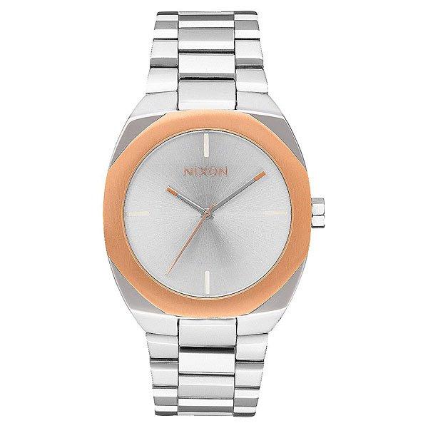 Кварцевые часы женские Nixon Catalyst Silver/Rose GoldСкульптурный дизайн, в котором все элементы конструкции гармонируют между собой - смелый геометрический безель и сложная палитра в часах Catalyst.Технические характеристики: Японский кварцевый механизм Miyota.Чистый, минимальный циферблат с маркерами на 12, 3, 6, 9 часов.Прочный корпус из нержавеющей стали.Восьмиугольной формы неповоротный безель.Закаленное минеральное стекло.Задняя крышка из нержавеющей стали.Стальной браслет с нестандартной пряжкой.<br><br>Тип: Кварцевые часы<br>Возраст: Взрослый<br>Пол: Женский