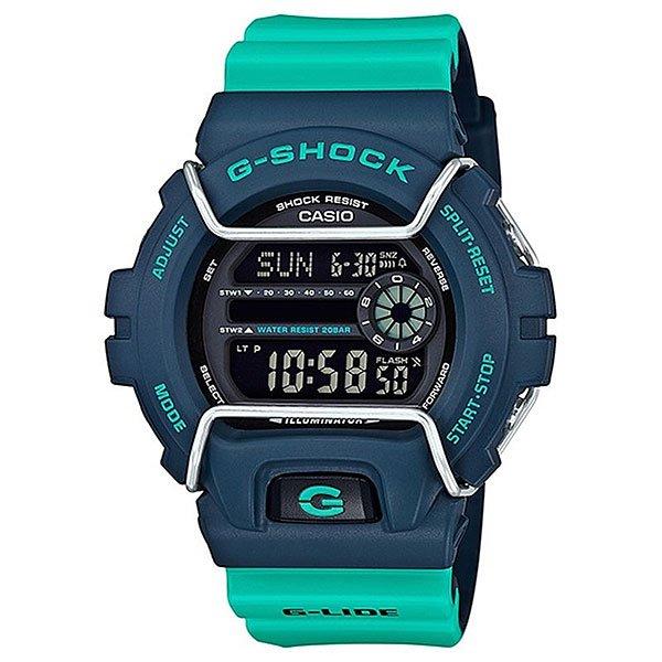 Кварцевые часы Casio G-shock 67584 Gls-6900-2aНовый представитель G-Lide нацелен на зимние виды спорта, где демонстрирует идеальную работоспособность при -20°С. Характеристики:G-Lide.Противоударный корпусзащищает механизм от ударов и вибрации. Модуль часов рассчитан на работу при низких температурах до -20°С/-4°F. Электролюминесцентная подсветка освещает весь циферблат. При повороте часов в сторону лица, подсветка включается автоматически.Мировое время– 48 городов (29 часовых поясов). Функция включения/отключения летнего времени.12-ти и 24-х часовой формат времени. Два секундомера с точностью показаний 1/100 сек и временем измерения 1000 часов.Сплит-хронограф.Таймер обратного отсчета от 1мин до 24ч с автоповтором. Функция отключения/включения звука. Световая индикация сигнала. 5 будильников, один с функцией Snooze, ежечасный сигнал. Автоматический календарь: число, день недели, месяц (до 2099г).<br><br>Цвет: синий,голубой<br>Тип: Кварцевые часы<br>Возраст: Взрослый<br>Пол: Мужской